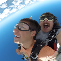 Male tandem student enjoying parachute flight while skydiving at Cleveland Skydiving Center near Akron, OH
